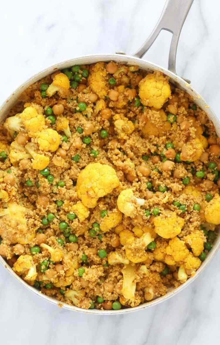 moroccan chickpea couscous in a skillet, ready to be served