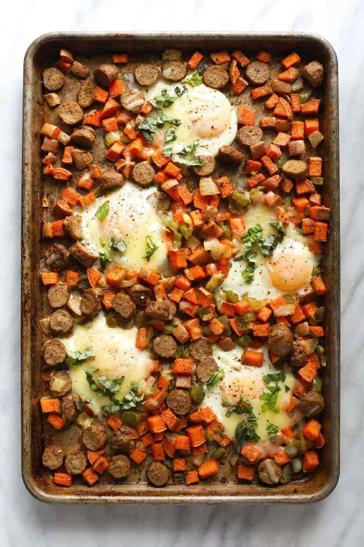 sheet pan with sweet potato hash and baked eggs