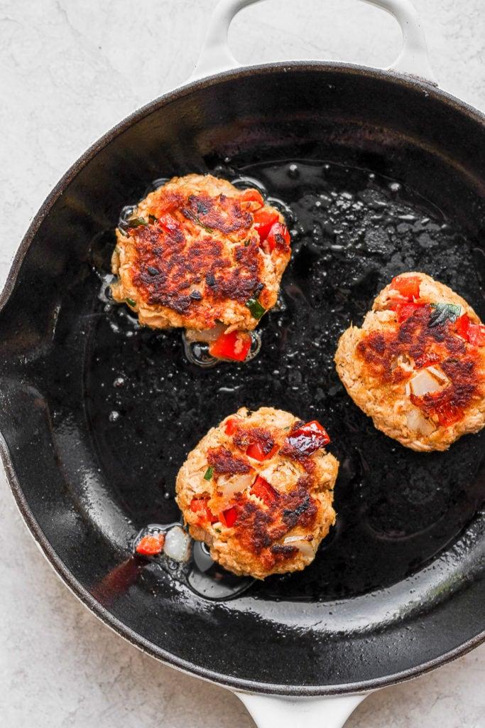 Salmon patties pan fry in a pan