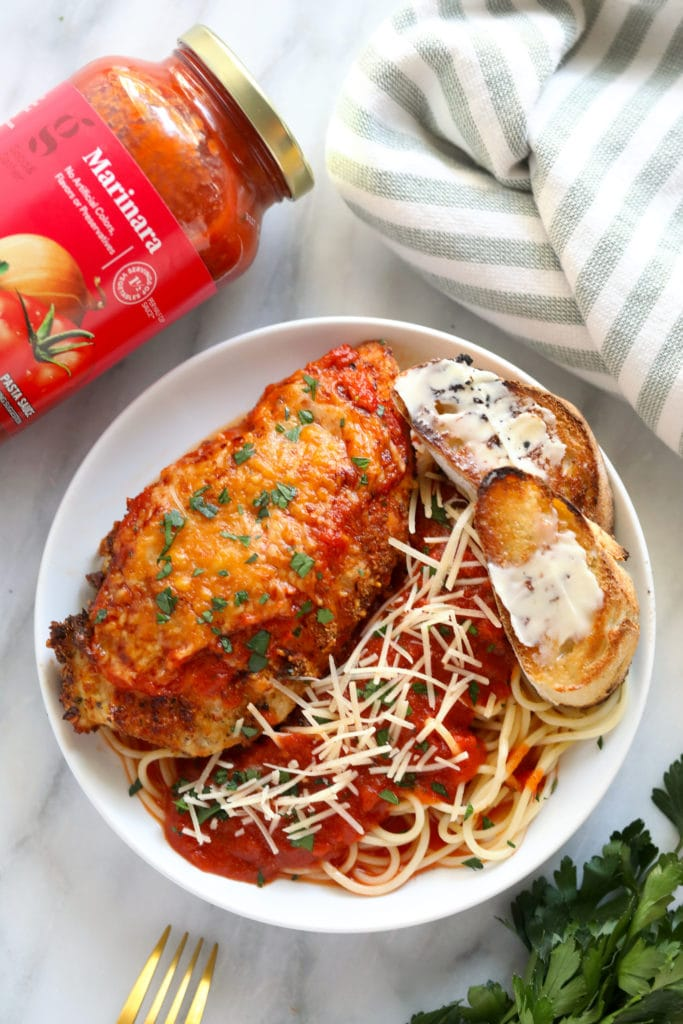 chicken parm on plate with marinara sauce