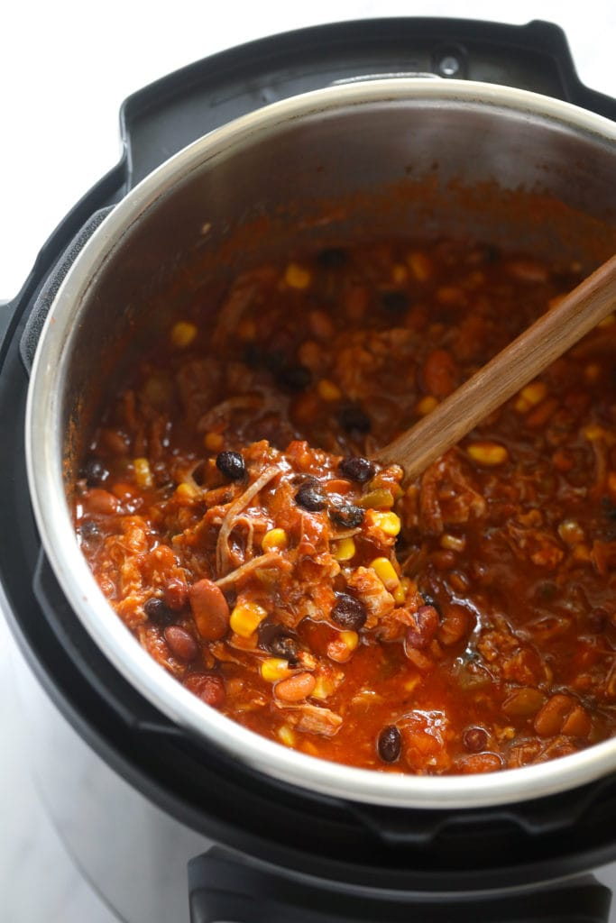 pulled pork chili in instant pot with spoon