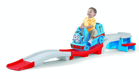 kid riding a toy Thomas the Train roller coaster
