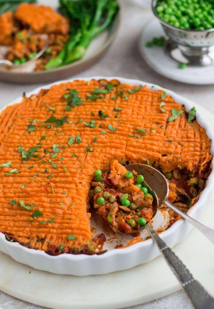 Vegan cottage pie & sweet potato mash in a round white dish