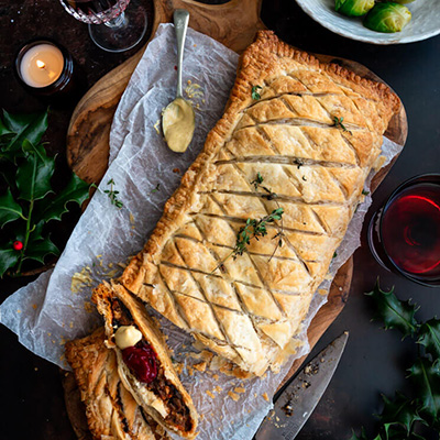 Vegan mushroom & walnut wellington on a black board