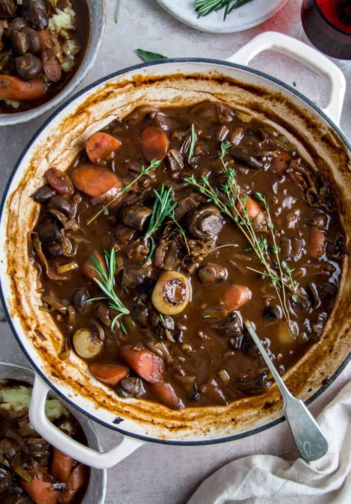 Vegan mushroom bourguignon in a white casserole dish