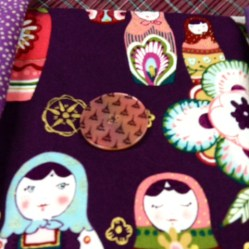 Testing the button on the doll fabric.