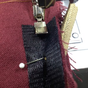 Sewing crotch seam below zipper.