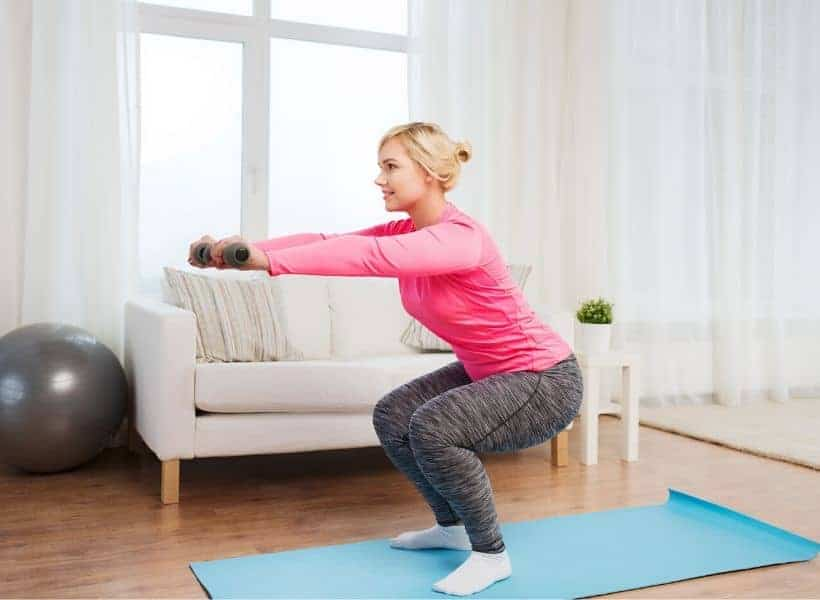 lady doing squats at home