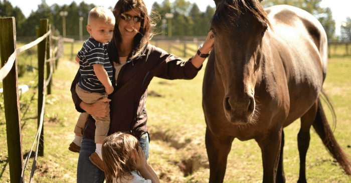 stephanie and kids with delilah the horse
