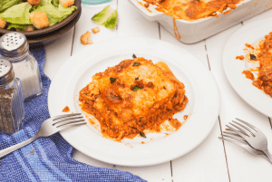 serving of low carb lasagna on a small plate with a fork