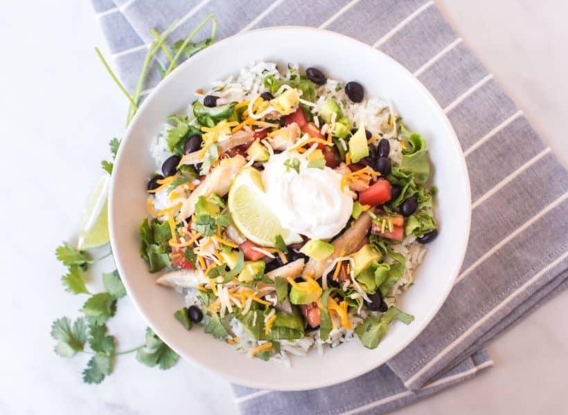 chicken burrito bowl with rice and veggies