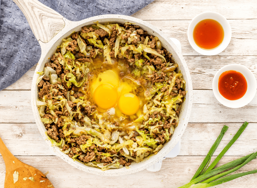 2 eggs added to the cabbage and ground beef mix