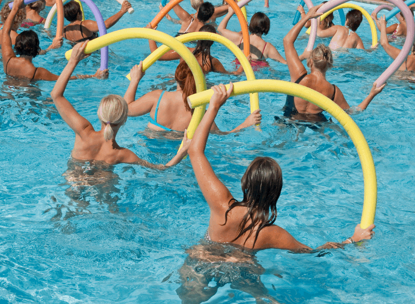 women doing water aerobics in swimming pool