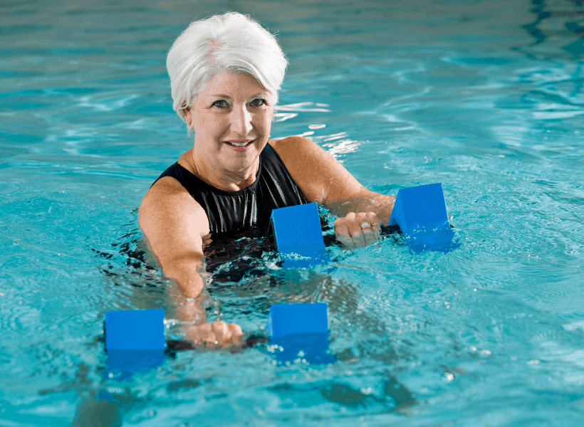 woman over 40 doing swimming aerobics to lose weight