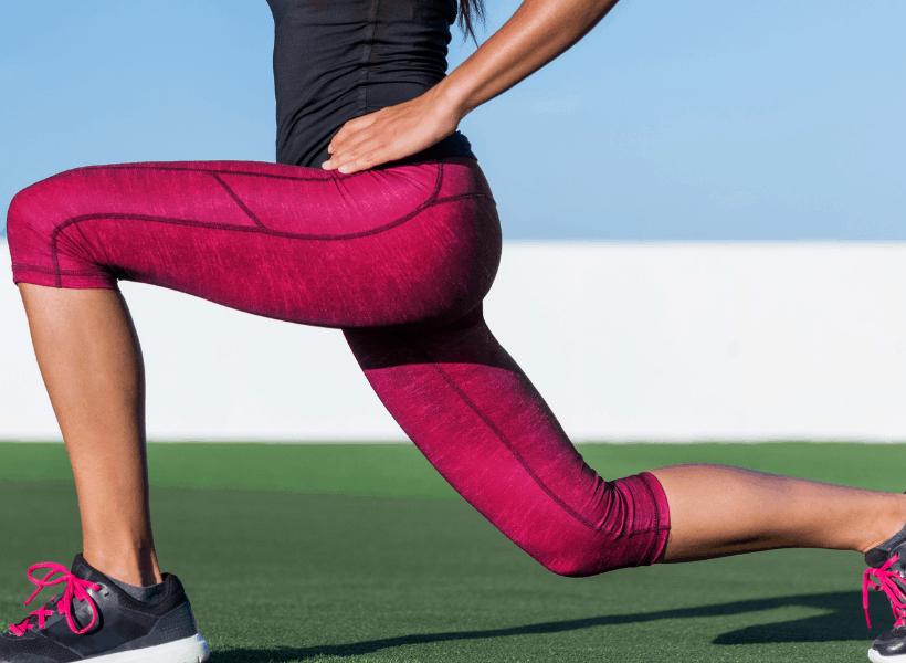 woman doing forward lunge leg workout