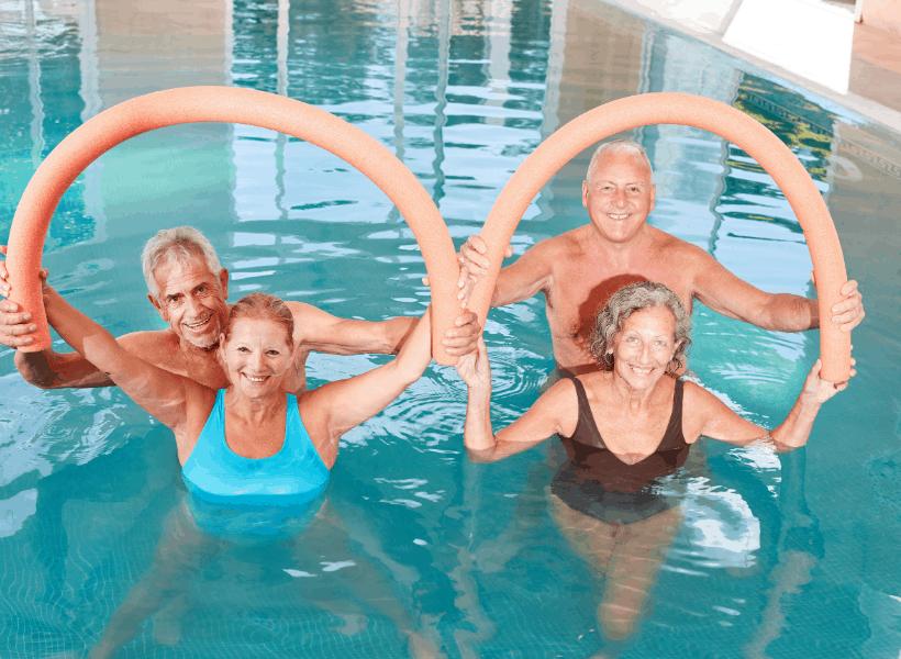 women strengthening swimming muscles in pool
