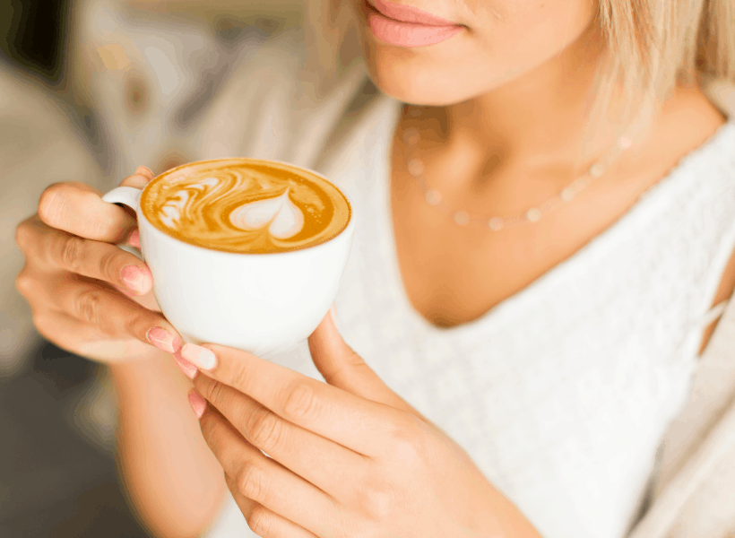 lady holding a cup of cacao butter coffee