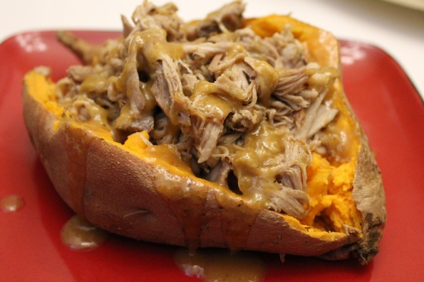 Slow Cooker Pulled Pork Stuffed Sweet Potatoes with Pineapple-Honey BBQ Sauce - an easy, flavorful and delicious paleo meal!