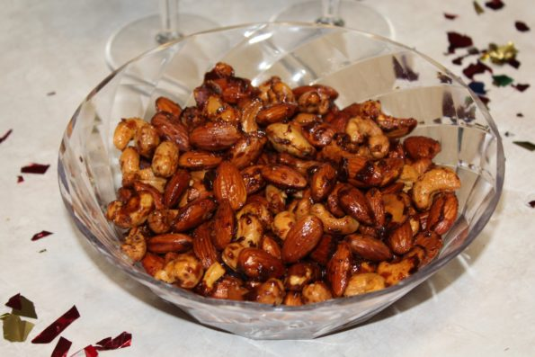 Spicy Maple Cashews and Almonds - If you're heading to a party on New Year's Eve and are looking for a tasty snack to bring, these Spicy Maple Almonds and Cashews will get gobbled up!