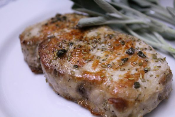 Paleo Honey Sage Pork Chops - Honey, sage and rosemary are combined to make a delicious flavor.  First seared to seal in the juices, then baked, this pork chop recipe is simple and tasty!