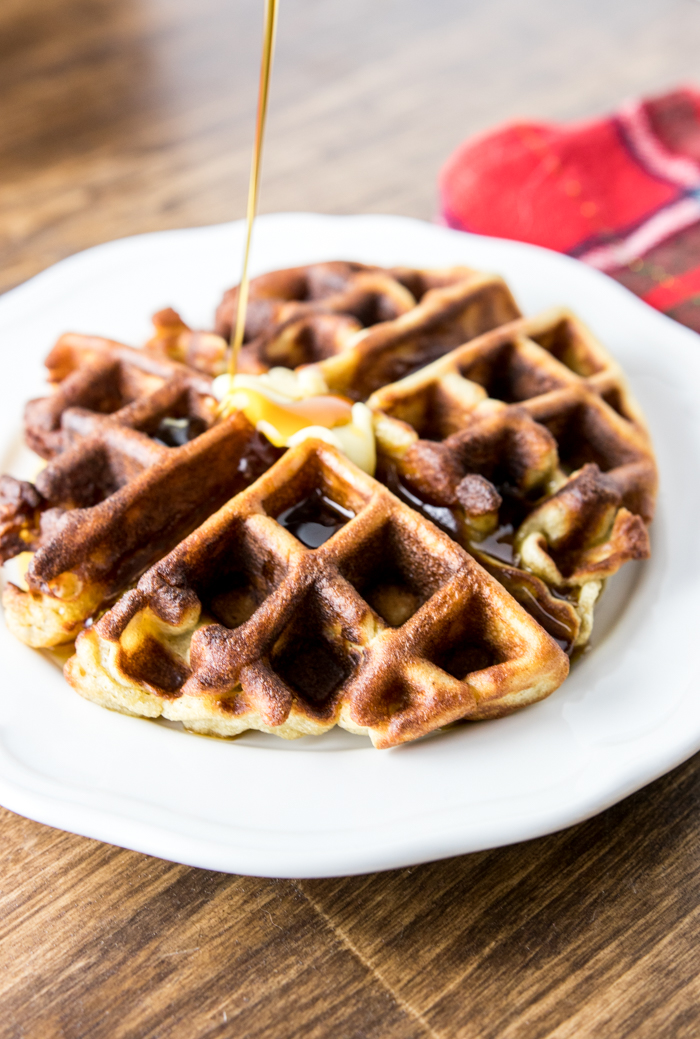 Pouring syrup on Paleo Gingerbread Waffle
