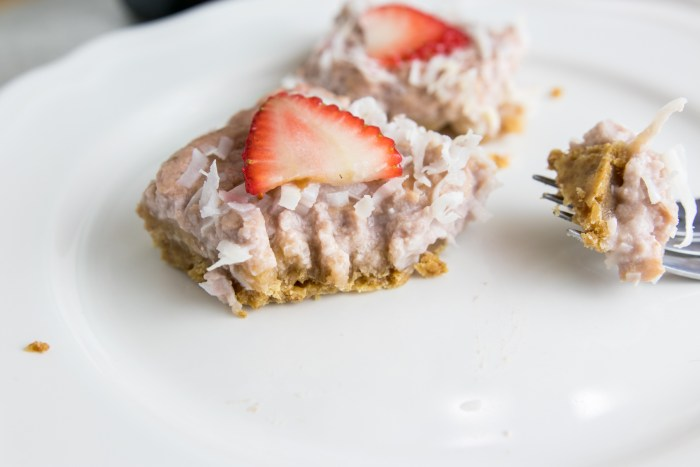 strawberry coconut bars with bite taken out