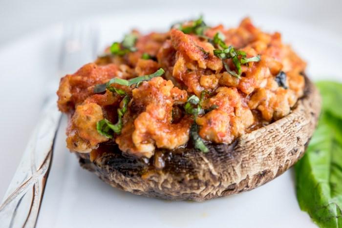 keto sausage pizza portobello mushrooms on a plate