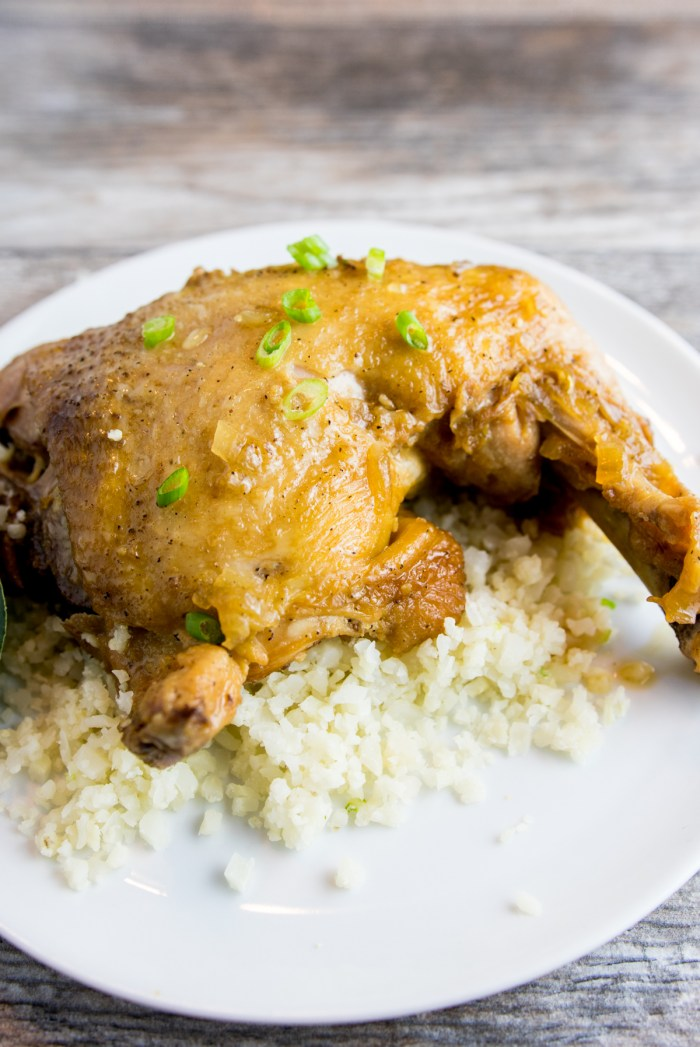 instant pot paleo adobo chicken on plate with cauliflower rice