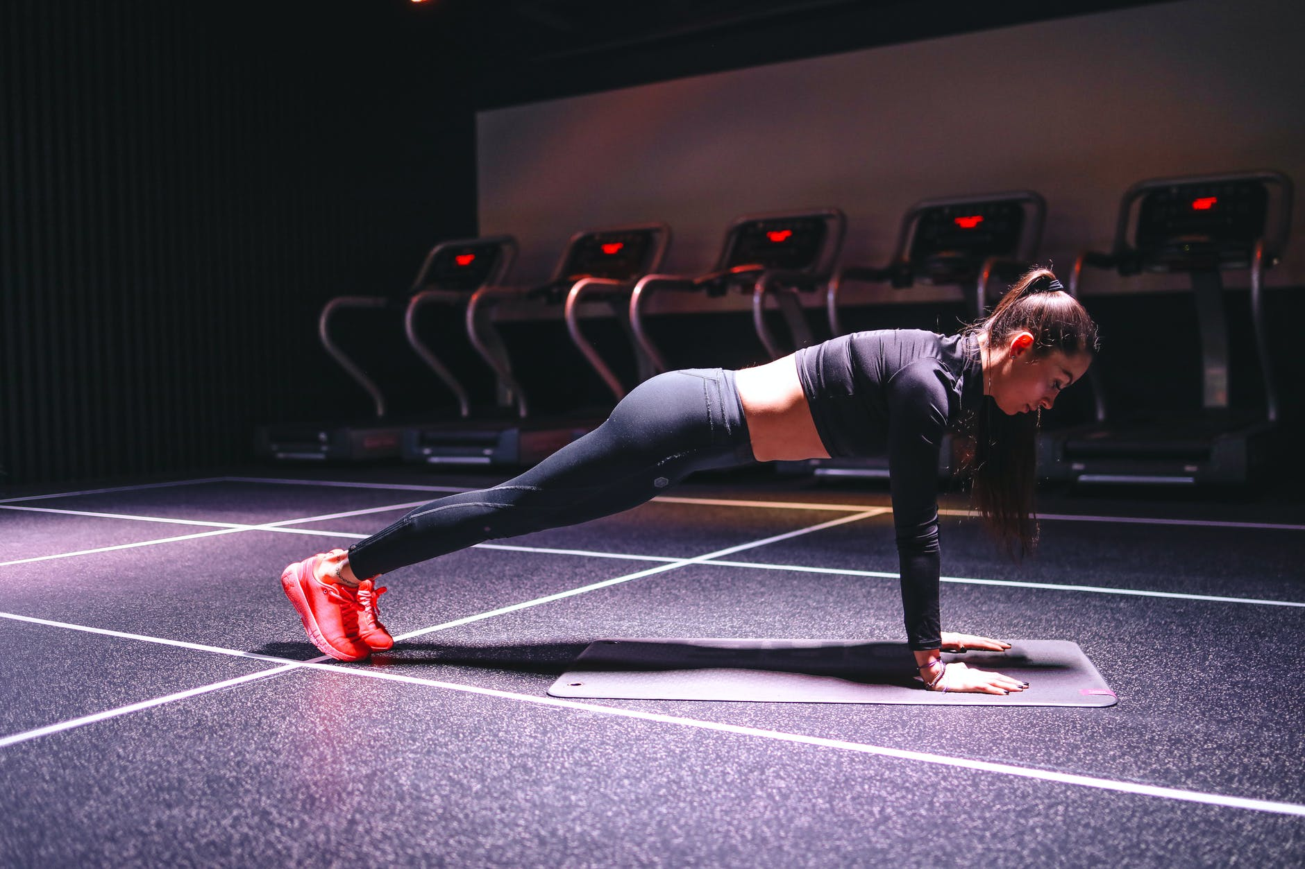 strong sportswoman standing in plank position