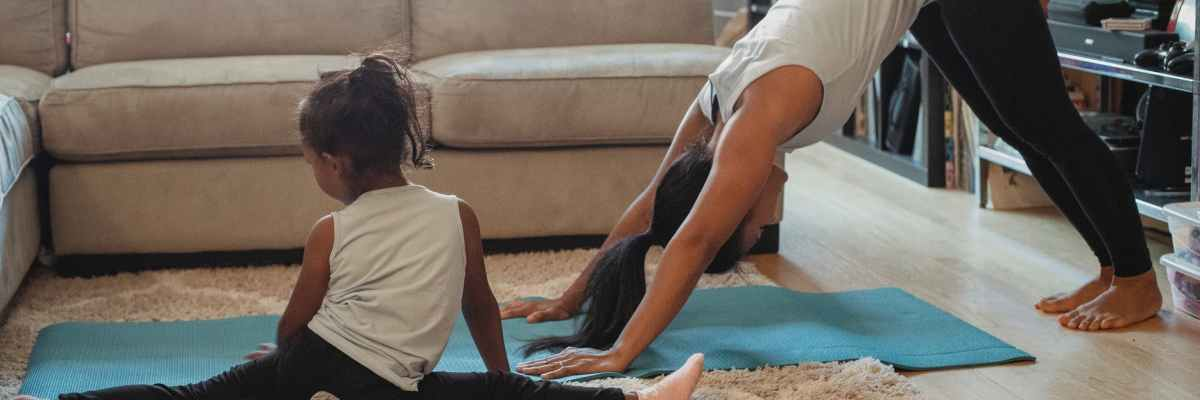 mom and daughter stretching at home