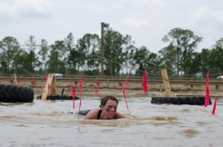 woman-crawling-mud-run-race
