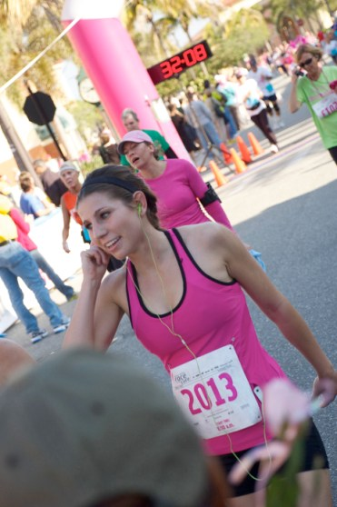 female runner wearing pink