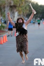 cave man running