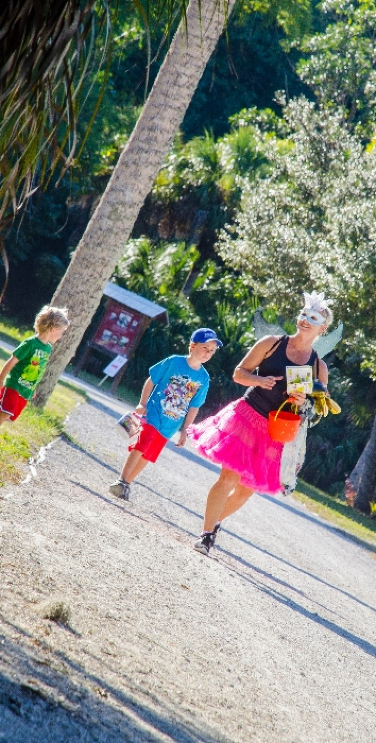 lady in costume walking with kids