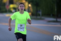 boy neon shirt running