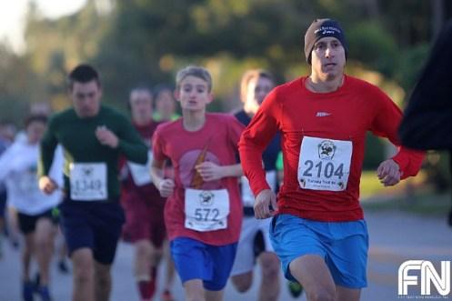 White Male Red Shirt Running