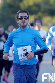 male sunglasses blue shirt running