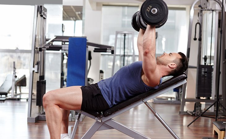 Man Doing The Incline Dumbbell Press Exercise For Chest