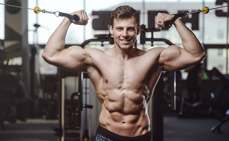 Man Working Out In A Cable Weight Machine