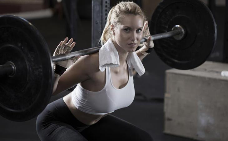 Fit Woman Carrying Out Squats For Legs