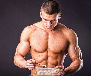 Sports Man Eating Portion of Food For Fitness
