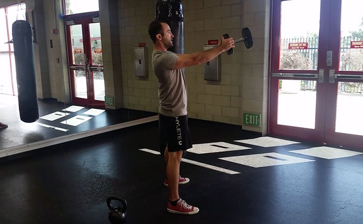 Man Using Dumbbell and Kettlebell Working Out