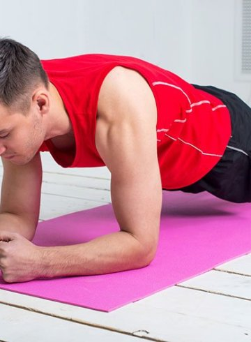 Fit Man About To Do A Plank Twist Exercise