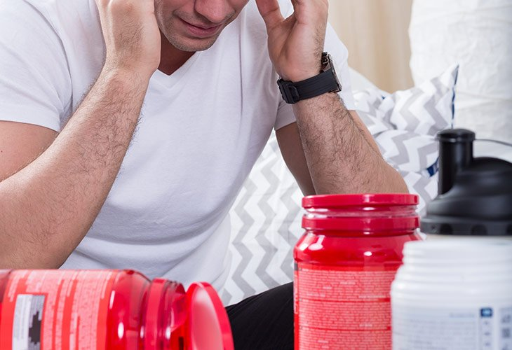 Man Thinking About Taking Pre-Workout Supplements