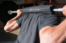 Fitness Man Using A Barbell Pad