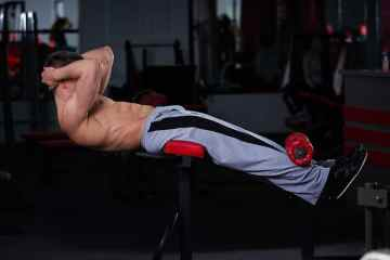 Man Using Sit Up Benches For Fitness
