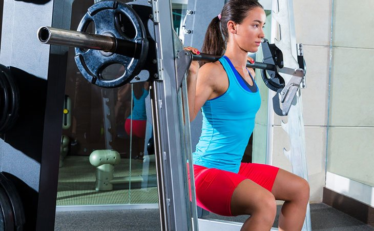 Woman Using Smith Machine Gluteus Maximus