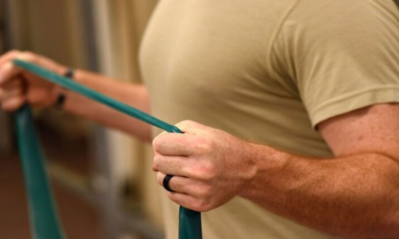 man doing stretches with resistance band