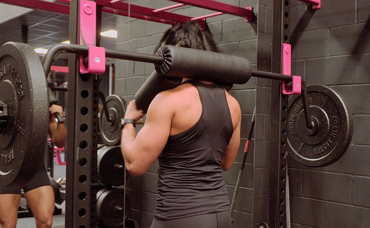 Woman Using A Safety Squat Bar