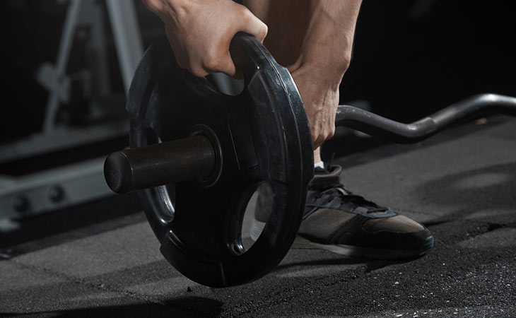Man Using Weight Sets For Fitness